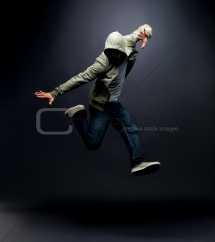Modern dance - Hip hop dancer posing on dark background