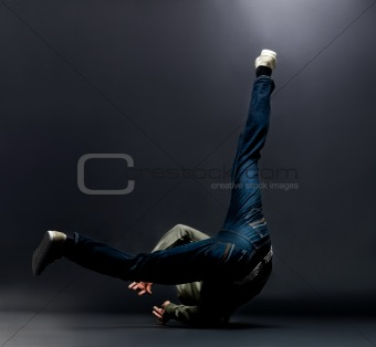 Urban dance - Young male breakdancer showing his dancing skills