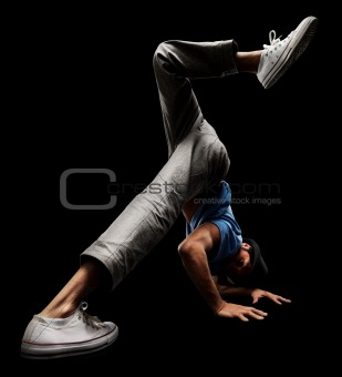 Young male street dancer showing his dancing skills