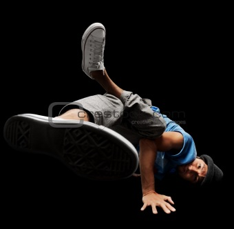 Stylish and cool breakdance style dancer on dark background