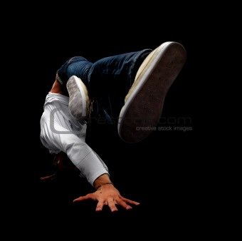 A street dancer performing a head spin