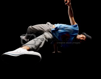 Young male hip hop dancer balancing on one hand