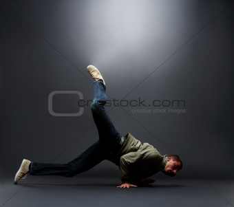 Portrait of a young male street dancer showing his dancing skills