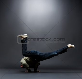 Modern style dance - Young male dancer balancing on hand