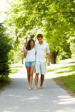 Portrait of beautiful young couple walking in park