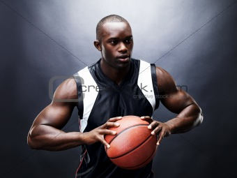 Young black guy in action with basketball