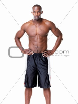 Muscular young guy posing confidently