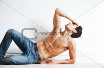Relaxed young male fashion model posing