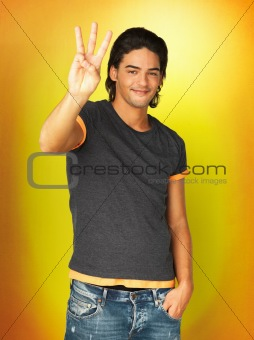 Casually dressed man holding up three fingers
