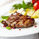 Gourmet grilled steak flavored with pink pepper and basil