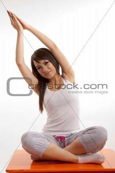 Attractive asian filipina woman doing yoga