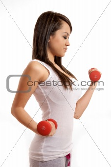 Attractive asian filipina woman lifting weights