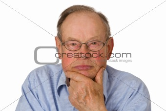 Male senior holding his chin