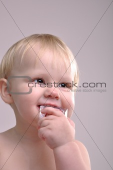 toddler biting a toy