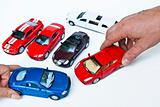 Models of car and hands
