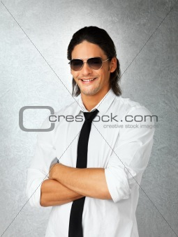 Smiling confident man against gray background