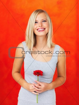 Beautiful woman holding daisy