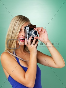 Woman photographer preparing to take photo