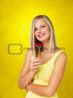 Attractive blonde holding daisy