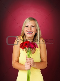 Pretty woman holding flower bouquet