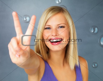Happy woman giving peace sign