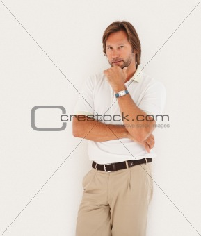 Portrait of a smart confident casual man standing against white