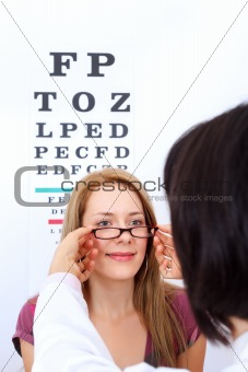 Woman buying glasses