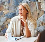 Woman contemplating over something while drinking coffee