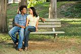 Couple on park bench.