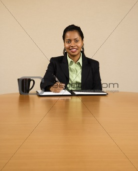 Businesswoman writing.