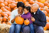 Family holding pumpkins.