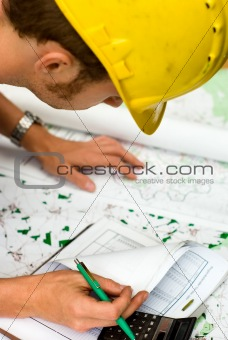 construction worker checking documents