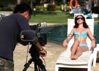 Beautiful woman and video-operator