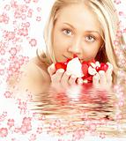happy blond in water with red and white flowers