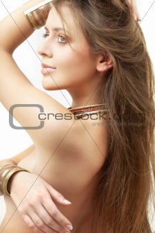 lovely girl in bronze bracelets