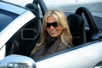 Blond girl in a car