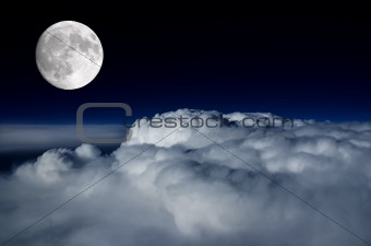 Full moon above cloud deck