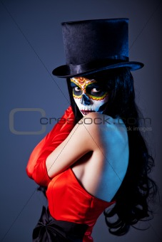 Sugar skull girl in tophat and red dress