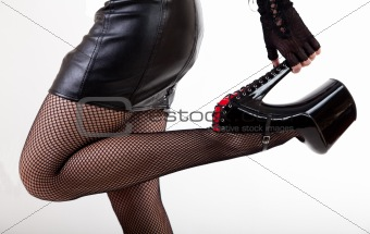 Sexy woman in high-heeled fetish shoes