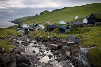 Houses and stream in the village of the Island Mykines, Faroe Islands