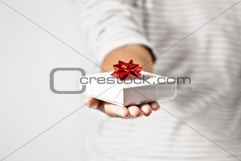 Young Woman Offering a Gift