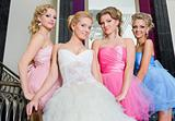 The bride with her bridesmaids on the stairs