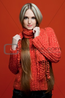beautiful woman in red with very long hair.