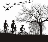 Family cycling in the countryside