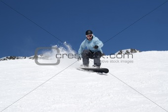 Snowboarding in snowy mountains