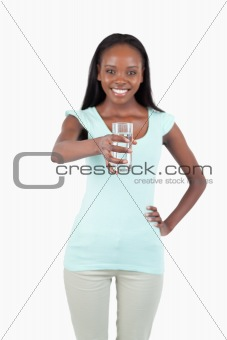 Smiling young water offering a glass of water