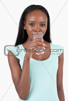 Young woman taking a sip of refreshing water