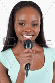 Close up of happy smiling female singer