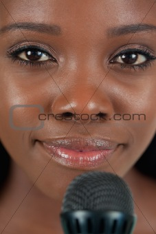 Close up of smiling female singer