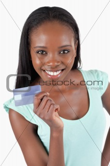 Smiling young woman showing her credit card